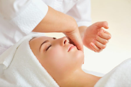 Beautiful woman at a facial massage at a spa salon.